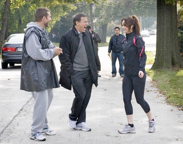 Director David O Russell with actors Bradley Cooper and Jennifer Lawrence on the set of Silver Linings Playbook