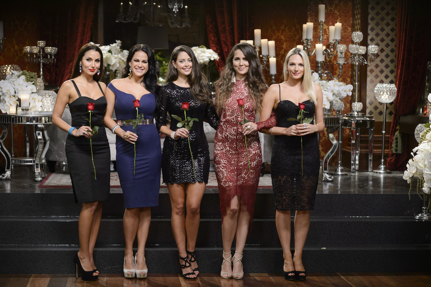 5 women holding roses during a season of The Bachelor